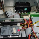 An image of the inside of the Fujitsu showing: an 8 gigabyte Hard Drive; 32 Megabytes of RAM; A Genuine Intel Pentium II (Clocked at 266MHz); a 100Mbs Network card; and the newly installed power supply